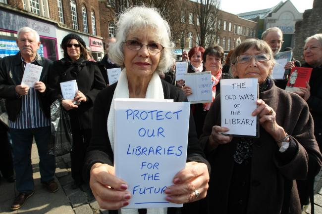Marie Raybould, front, and Friends of Cobbett Road Library in a protest against proposed library closures,