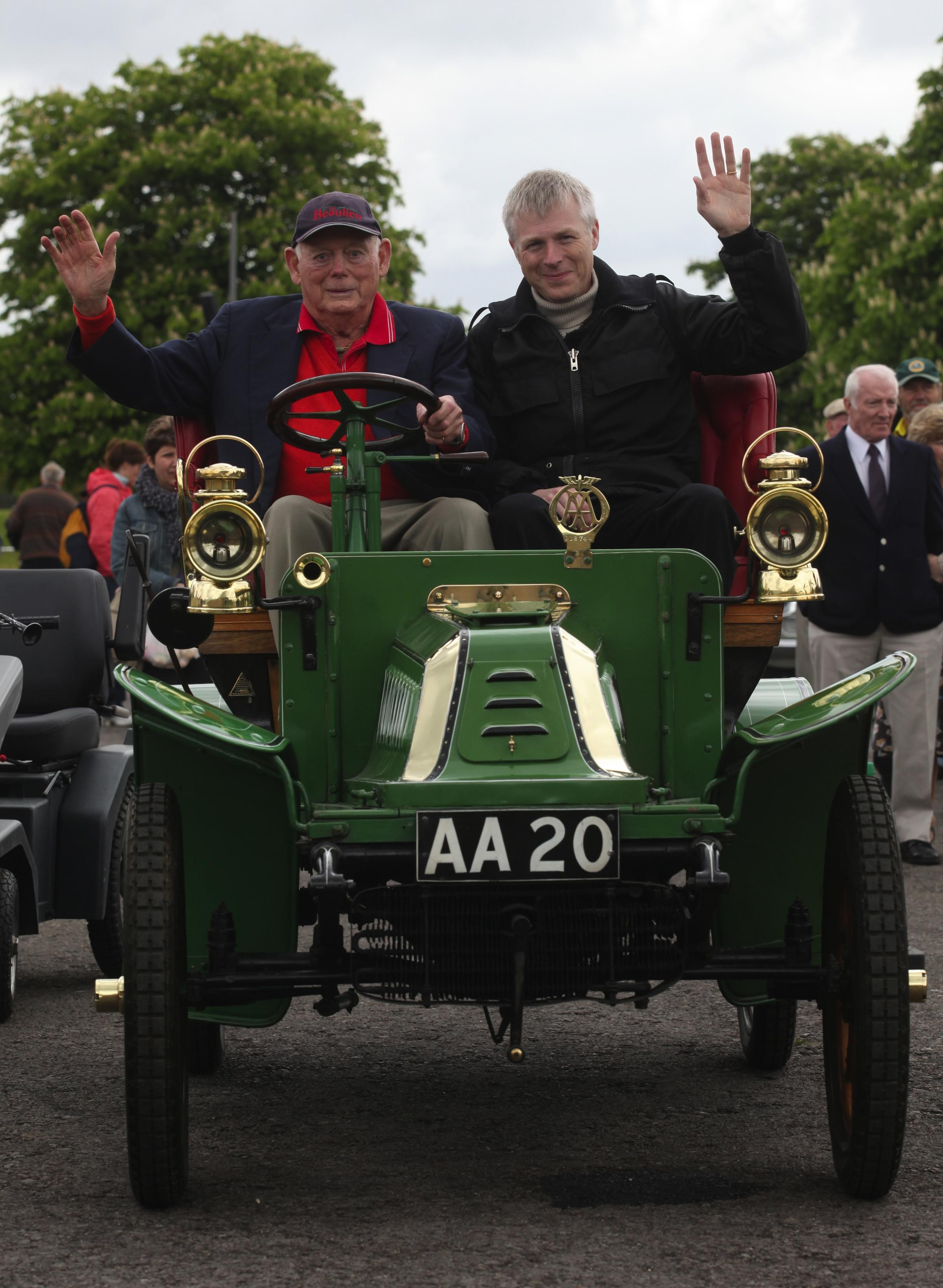 Lord Montagu and Ralph Montagu in a 1903 De Dian Bouton during the 50th Anniversary of the National Motor Museum at Beaulieu.