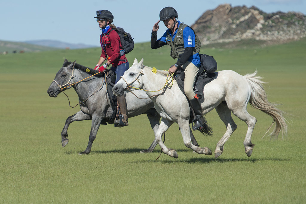 Iain Hayter, right, sets off on the Mongol Derby, in which he would fall and break his back in five places