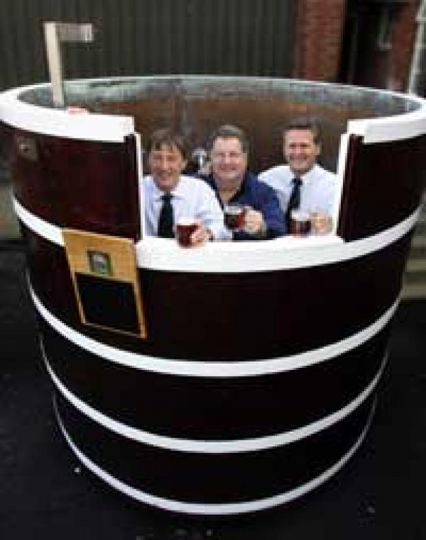 THREE MEN IN A TUB: Derek Lowe, Bob Mavin and Jeff Drew in the fementing tub.