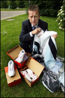Phil Thomas of Hampshire Trading Standards with some of the goods.