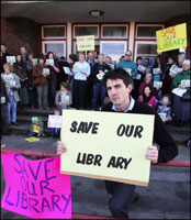 Campaigners protest to keep the library open.