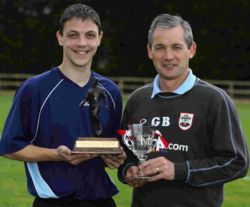 George Burley helps Chris Baird show off his player of the year trophies at Staplewood last month.