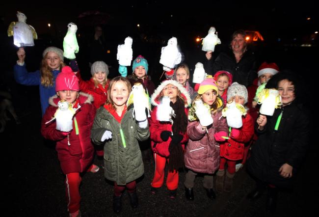 PICTURES: FA Cup Fans Choir take part in Totton lantern parade