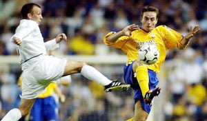 CRUNCH TIME: Leeds United's Jody Morris tries to win the ball from Matt Oakley.