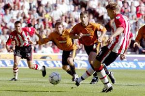SPOT ON: James Beattie opens the scoring against Wolves by converting this penalty. Pictures by Stuart Martin