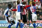 FLASHPOINT: Andy Cole, left, clenches his fist as trouble erupts at St Mary's. Echo photo by Stuart Martin.