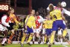 GOALMOUTH SCRAMBLE: James Beattie jumps with Sol Campbell in the penalty area as Saints throw everything at Arsenal, with Brett Ormerod and Kevin Phillips waiting to pick up any loose ball. Echo picture by Chris Moorhouse