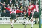 TIME TO CELEBRATE: Rory Delap is joined by delighted teammates after scoring a spectacular goal
