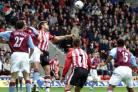 GETTING AHEAD: James Beattie is first to the ball as Saints draw 1-1 with Aston Villa at St Mary's. Echo picture by Chris Moorhouse