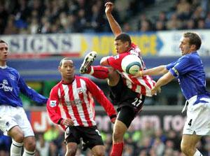IN THE THICK OF IT: Leon Best beats Alan Stubbs watched by fellow debutant Dexter Blackstock.