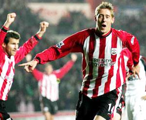 NOT BAD FOR STARTERS: Peter Crouch celebrates scoring on his first Premiership start for Saints