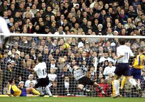 FULL STRETCH: Goalkeeper Antti Niemi can do nothing to stop Jermain Defoe's opening goal at White Hart Lane.