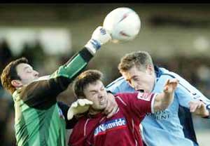 POSING A THREAT: Peter Crouch, right, takes on Ashley Westwood and keeper Lee Harper. Echo picture: Paul Collins.