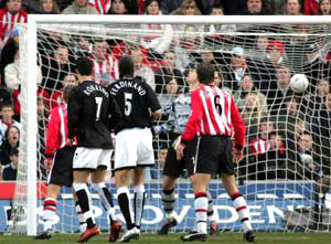 EARLY SHOCK: Roy Keane's second-minute blast hits the back of the Saints net. Echo picture by Paul Collins.