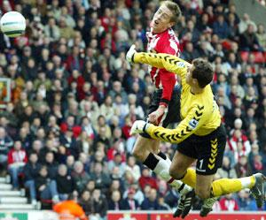 AERIAL BATTLE: Saints striker Peter Crouch collides with Aston Villa goalkeeper Thomas Sorensen.
