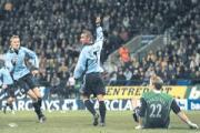 GOAL-DEN MOMENT: Kevin Phillips wheels away after netting Saints' leveller, to the delight of Peter Crouch.