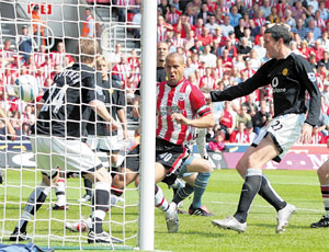 FLYING START: Saints go into the lead as Quashie piles on the pressure and United's John O'Shea puts into his own net.