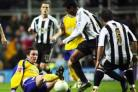 SLIDE RULE: Matt Oakley tackles Newcastle's Nolberto Solano. Daily Echo picture by Paul Collins
