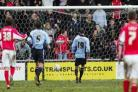 POWERLESS: Claus Lundekvam and Danny Higginbotham can only watch as Crewe's leveller hits the back of the net.