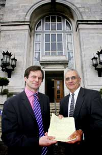 LEFT: Councillor Peter Baillie, left, accepts a petition against the proposed closure of some of Southampton's schools from Pete Sopowski, Secretary of Southampton Teacher's Association (NUT) last night.