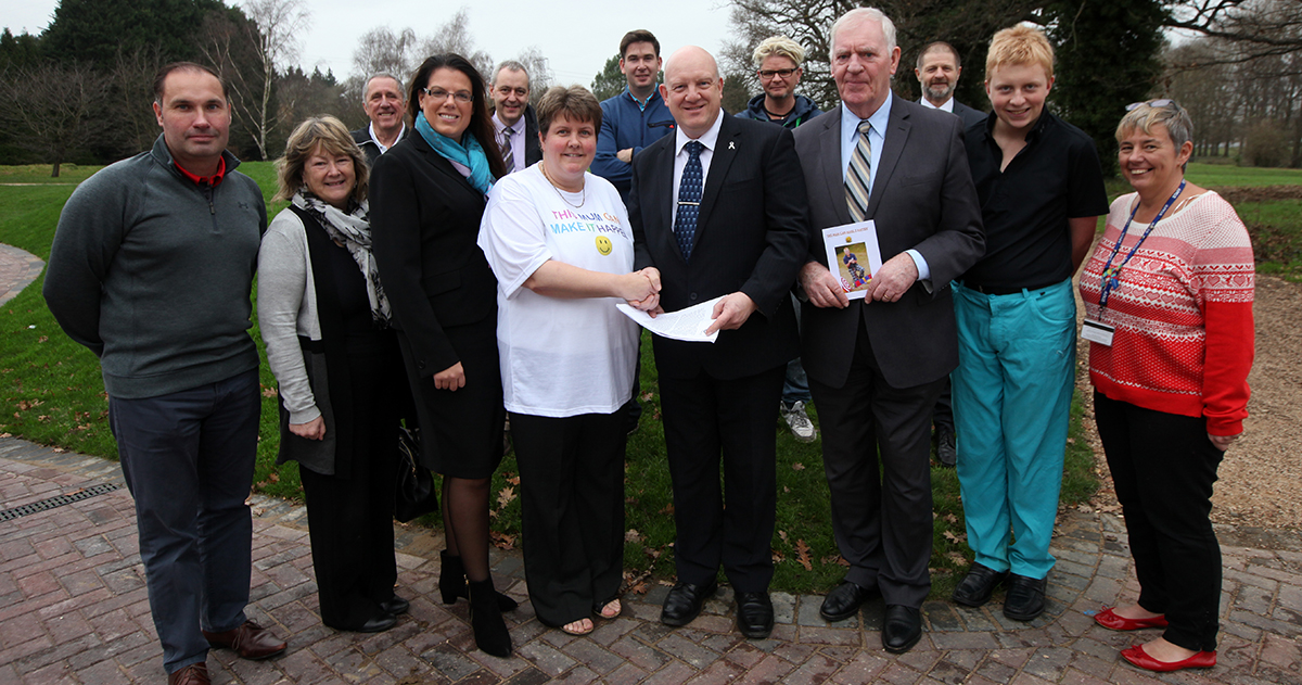 Dawn Osborn (in white) presents her 'This mum can make it happen campaign' to Andy Wright, compliance officer of the PGA, on behalf of her son Warren Clark, second right, along with supporters including Caroline Nokes MP and Saints legend Lawrie McMen
