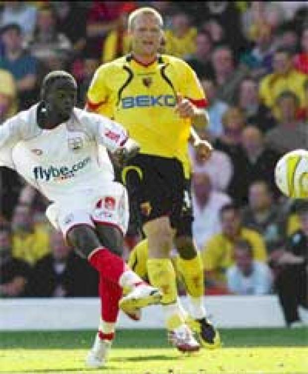 Daily Echo: WONDERKID: Watford defenders can only stand and watch as Nathan Dyer delivers his superb goal.