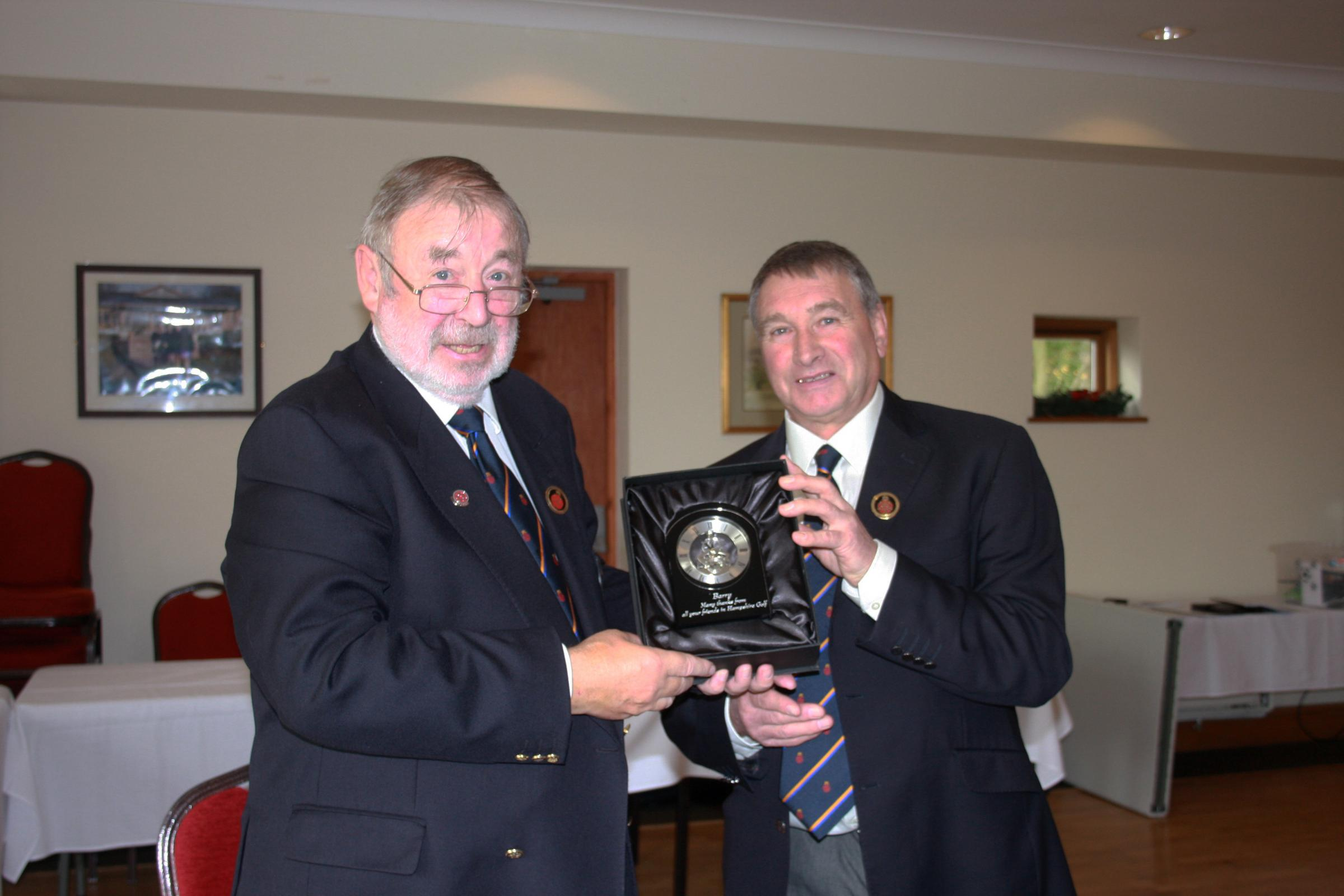 John Moore (Blackmoor GC) hands a leaving gift to immediate past president Barry Morgan (Liphook) at the Hampshire Golf Union AGM, at Basingstoke GC, on December 10, 2015.