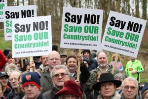 PHOTOS: More than 100 protesters march against plans for 3,700 homes in countryside