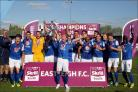 Eastleigh players celebrate winning the Conference South in 2014