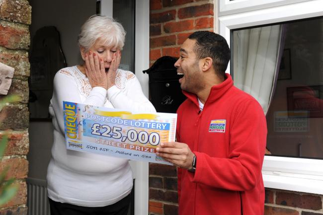 Lottery winner Christine Boyce with People's Postcode Lottery ambassador Danyl Johnson
