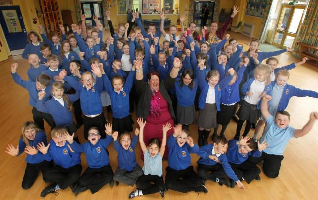 Wildground pupils and staff including headteacher Amanda Mullett celebrate the school's 'Good' Ofsted report