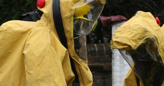 A firefighter in a hazardous chemical suit