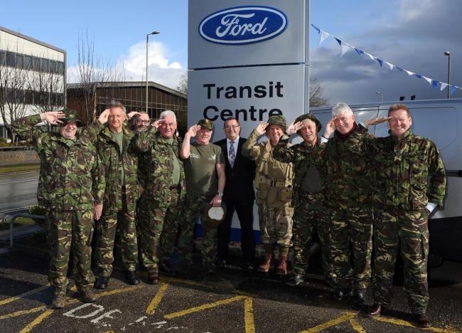 Walk in the footsteps of Heroes team salute their sponsors Hendy Ford prior to their sponsored walk in Normandy
