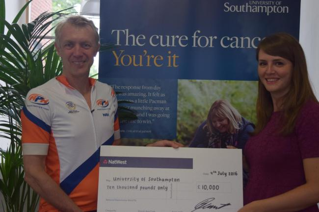 Nick Caunter handing over the cheque. Photo: Centre for Cancer Immunology – University of Southampton