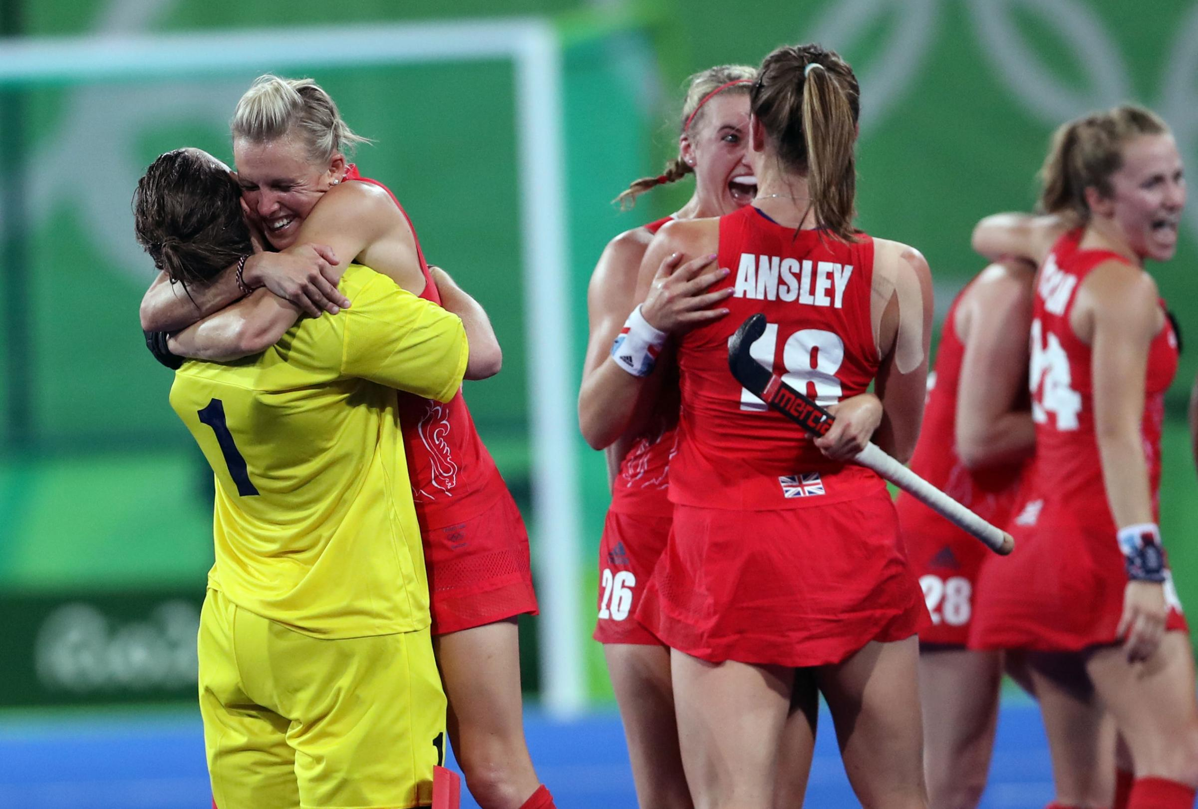 Alex Danson celebrates with Team GB teammates after the final whistle
