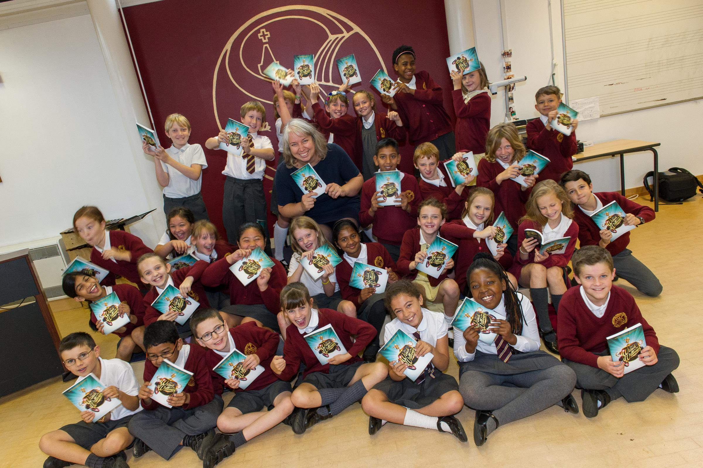 Springhill school Yr 5 children with copies of The Wind in the Willows