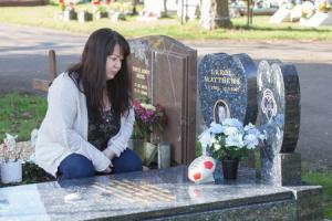 Errol Matthews headstone has been vandalised. His father is urging people to be respectful of the new headstone..Pictured : Errol's sister, Tracy Matthews near his grave at St Mary Extra Cemetry, Portsmouth Road, Southampton...Photography by Habibur R