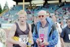 Mike Smith with Iwan Thomas at the British Championships in Birmingham, July 1997