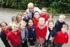 TOP MARKS: Freemantle Church of England Infant School pupils with head teacher Kevin Barnett. 	Echo picture by Joanna Mann.