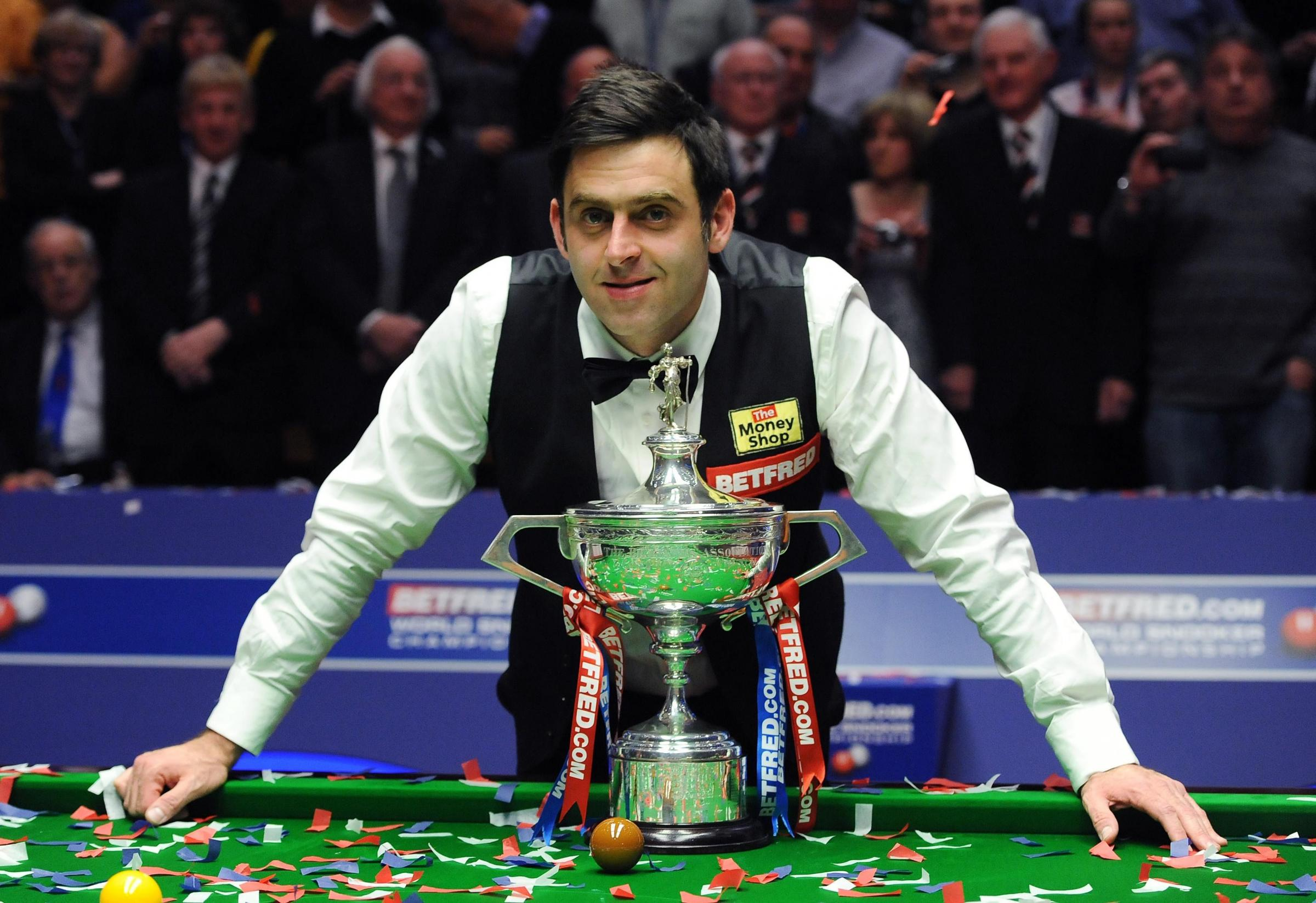 England's Ronnie O'Sullivan celebrates his victory with the trophy after the final during the Final of the Betfred.com World Snooker Championships at the Crucible Theatre, Sheffield. PRESS ASSOCIATION Photo. Picture date: Monday May 7, 2012. See P