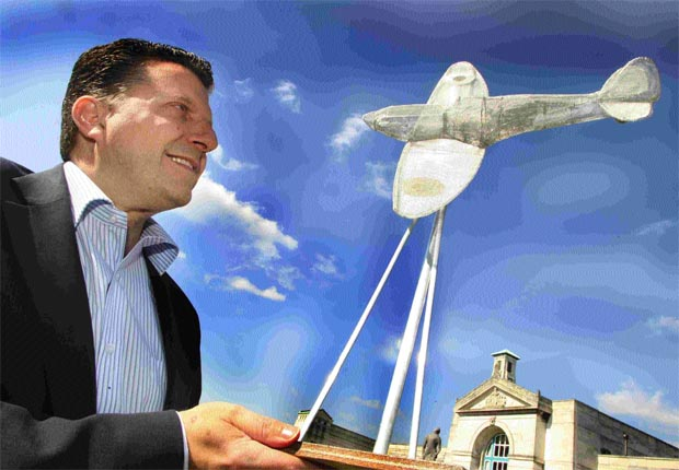 AIRBORNE: Cllr Hannides with a model of the proposed design.
