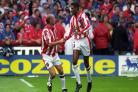 Brian Deane (right) celebrates scoring the first goal in the Premier League (PA)