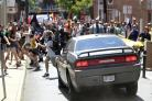 A vehicle drives into a group of protesters demonstrating against a white nationalist rally in Charlottesville