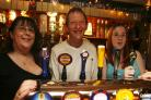 The Wheel Inn, Sway Road, Lymington, for Taste review, L to R, Marie and Pete Walters with Laura Richards.