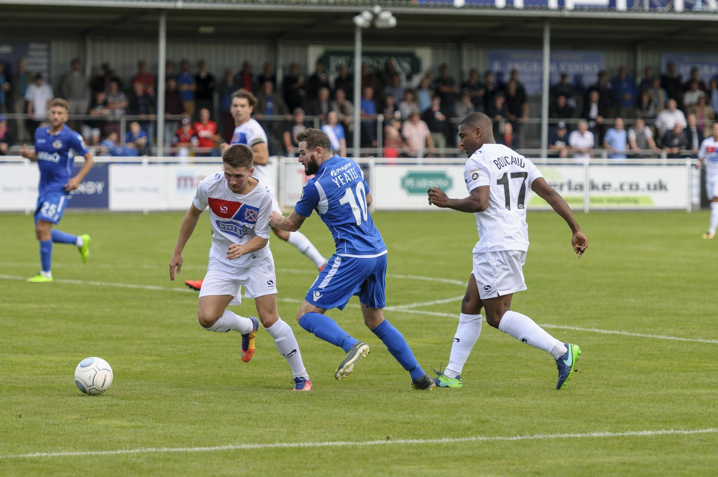 Eastleigh's Mark Yeates (centre)
