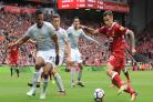Manchester United's Antonio Valencia and Liverpool's Philippe Coutinho battle for the ball