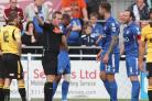 Andrew Boyce sees red against Hereford last week, flanked by Gavin Hoyte (left) and skipper Sam Togwell (right).