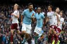Sergio Aguero celebrates equalling Manchester City's goalscoring record