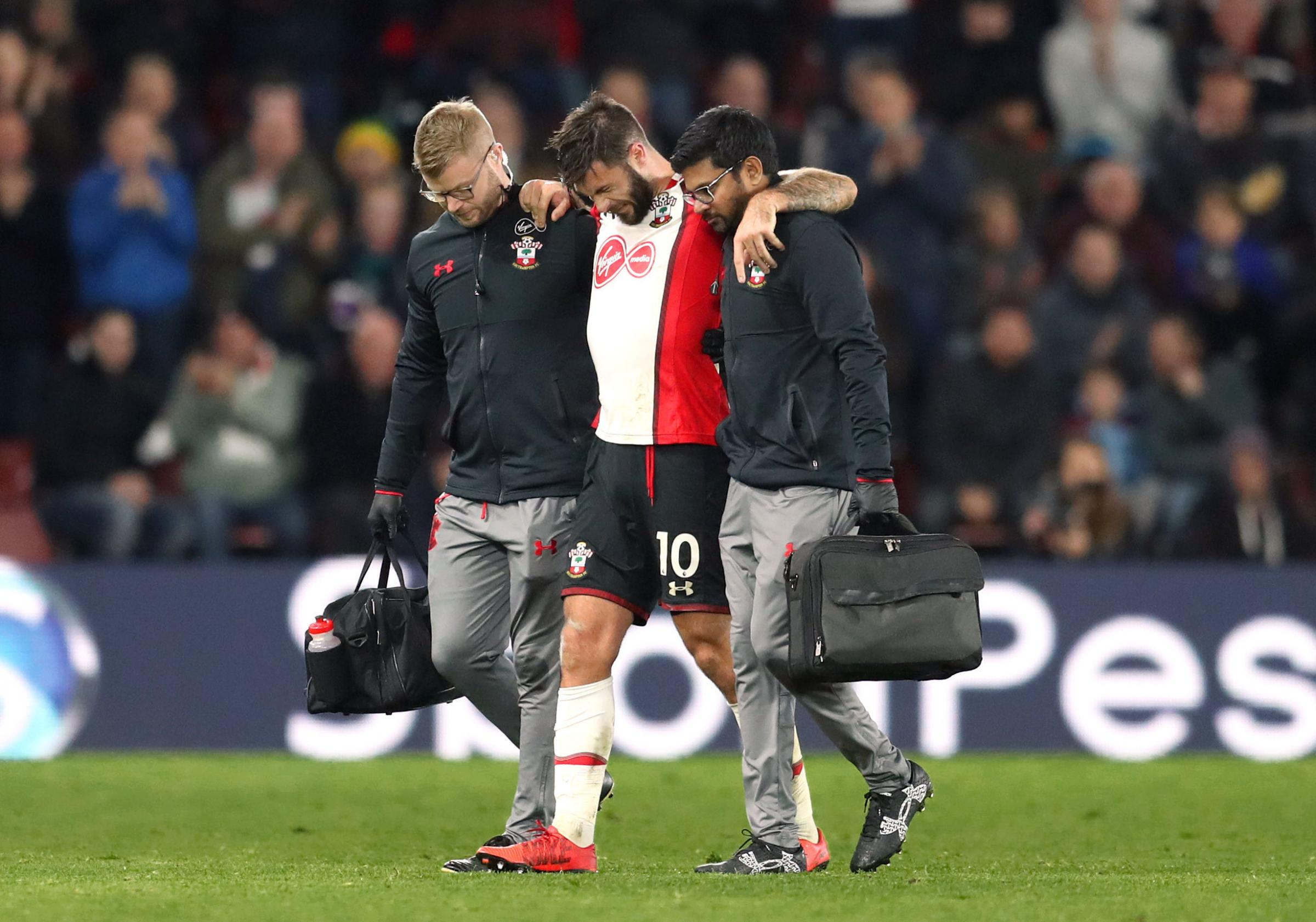 Charlie Austin limps off injured